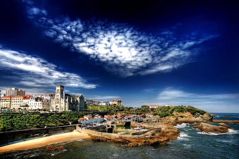 Biarritz vacation France. Beautiful clouds above Biarritz Harbor. Biarritz travel France.