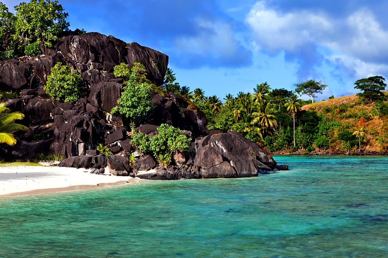 Bora-Bora holidays. French Polynesia sandy beaches. Tahiti black rocks sunny day landscape. Bora-Bora island tours.