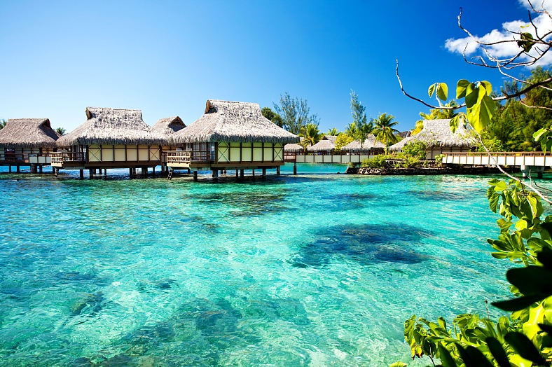 Bora Bora resorts. Over water bungalows with amazing green lagoon. Bora Bora vacation.