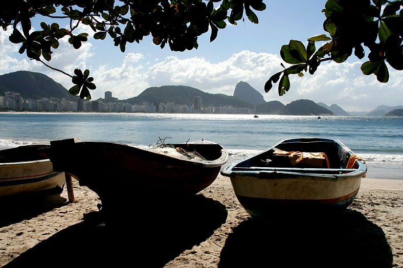 Brazil travel. Fishing boats, sands of Copacabana beach. Sugar Loaf mountain. Rio de Janeiro, Brazil tours