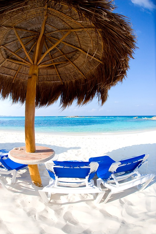 Mexico resorts. Table and chairs on sandy beach in Mexico. Cancun resorts.