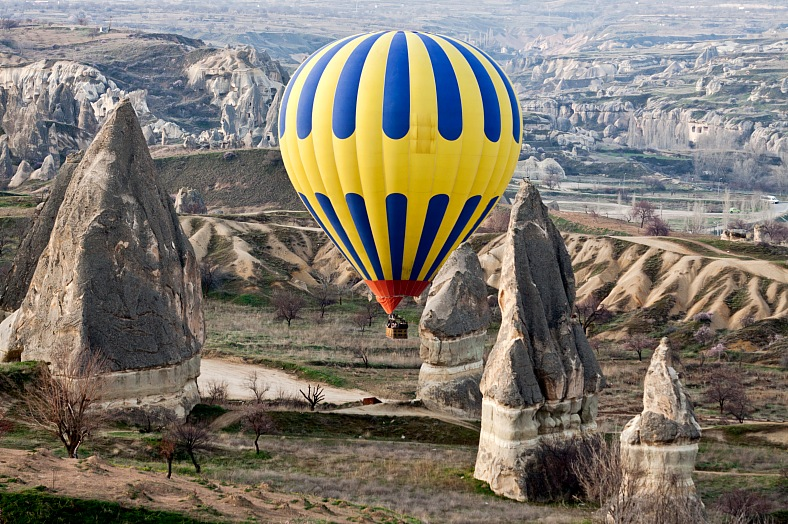 Turkey tours. Hot air balloon over rock formations in Cappadocia. Turkey vacations - vacation travel photos