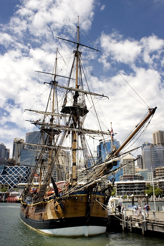 Travel Australia. A Replica of Captain Cooks Endeavor docks at the Darling Harbour, Maritime Museum. Sydney tours.