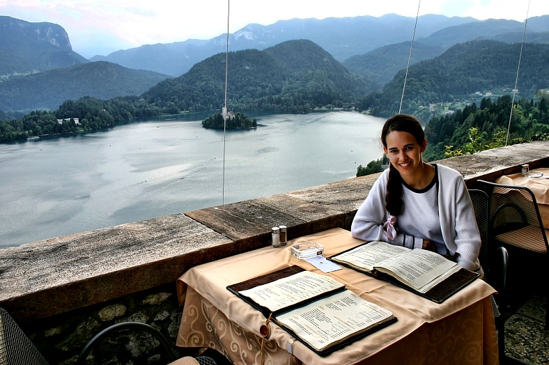Slovenia travel. Woman in the restaurant of Castle Bled, overlooking Lake Bled, Slovenia vacations.