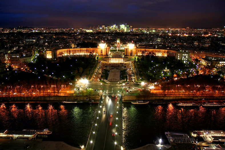 Paris trips. Skyline from Eiffel Tower at night. Paris vacation packages.