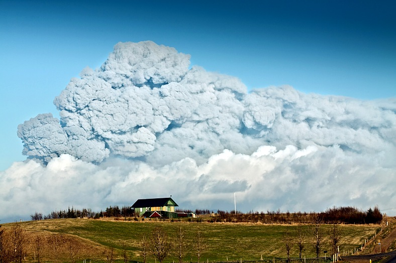 Iceland travel. Summer House clouse to Eyjafjallajokull volcano. Iceland tourism.