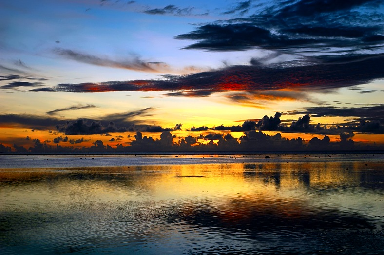 Fiji holidays - Fiji sunset after storm. Oceanic sunset on Fiji islands. Fiji tours - vacation travel photos