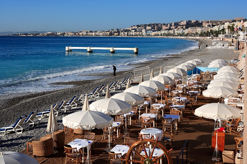 French Riviera honeymoon. Beach restaurant at Nice. French Riviera vacations - vacation travel photos