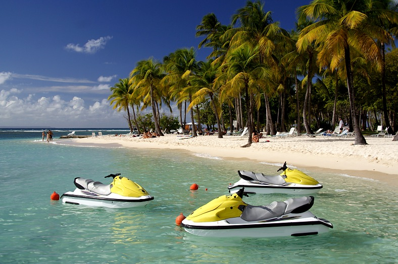 Guadeloupe tourism. Beautiful caribbean lagoon with three jetskis. Caribbean Watersports.
