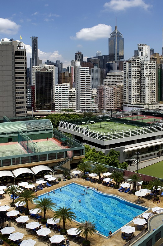 Hong Kong tours. Roof top sport complex with swimming pool and tennis courts in downtown. Hong Kong travel.