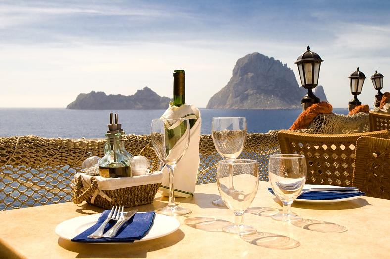 Ibiza vacations. Restaurant with sea view in front of Es Vedra. Ibiza tours, Spain vacations.