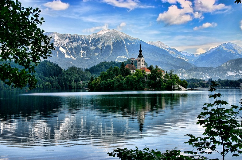 Slovenia travel. Lake Bled, island with a church and Julian Alps in the background. Slovenia vacations.
