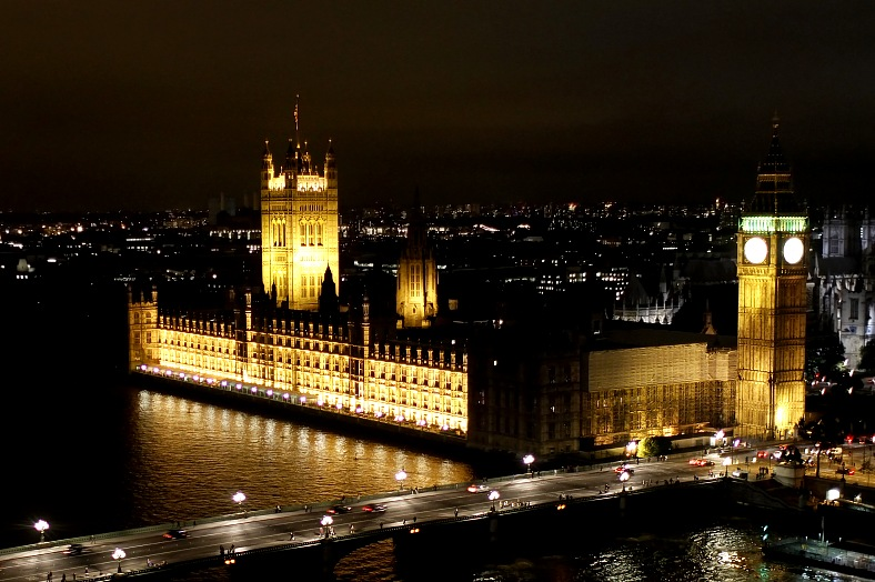 London tours night scene, Big Ben and Westminster Abbey. London holidays.