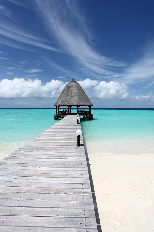 Maldives holidays. Walk of freedom -  A runway from a Maldivian island beach to a relaxation point. Maldives vacation.