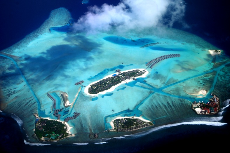 Maldives islands vacations. Aerial view of tropical islands in Indian ocean. Group of hotels. Maldives tours.
