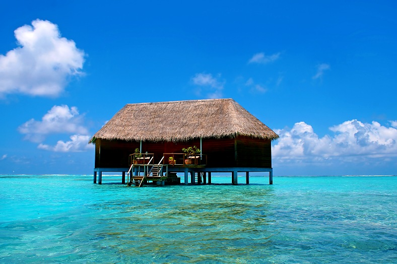 Maldives vacations. Water villa and turquoise water on Meeru Island. Maldives tours.