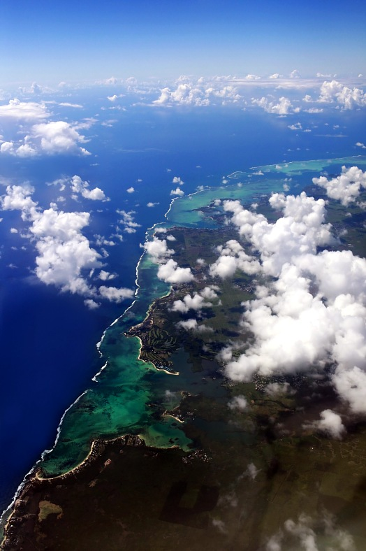 Mauritius flights. Aerial view of Mauritius island with clouds. Mauritius vacations.