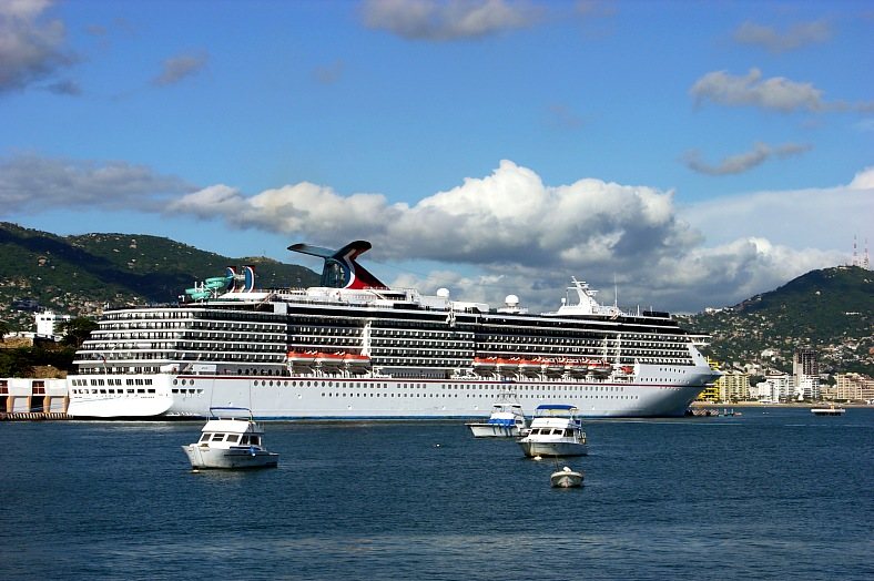 Mexico tours. The cruise liner anchored at the pier of Acapulco city. Mexico travel.