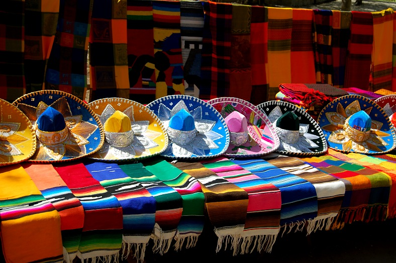 Mexico resorts. Colorful Mexican hats and shawls display. Mexico vacations.