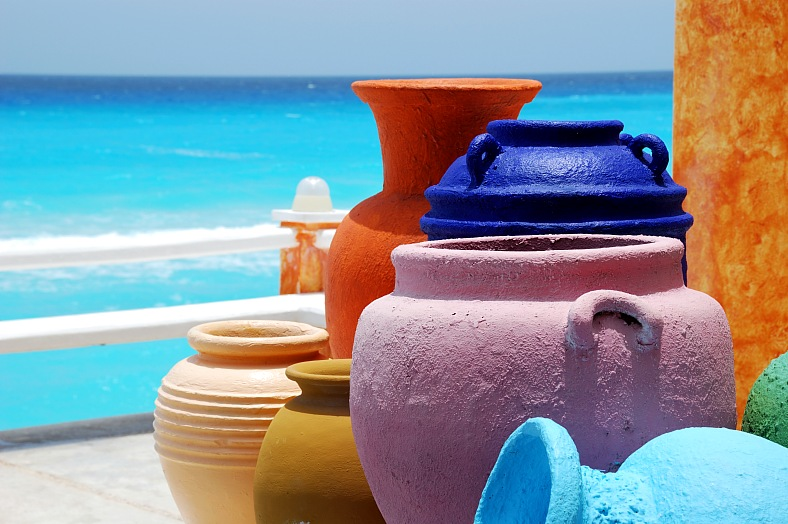 Mexico vacations. Cancun resorts - colorful clay pots with blue caribbean ocean. Mexico travel - vacation travel photos
