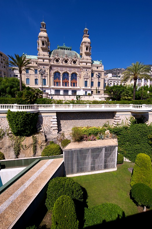 Monaco vacation. Rear view of the Monte Carlo Casino featuring the casino gardens. Monaco tours.