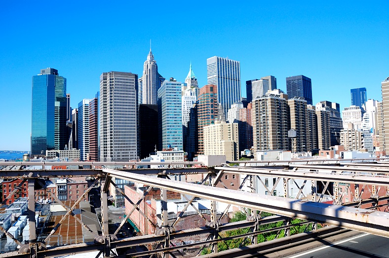 USA travel - New York City view. USA tours. New York City skyline from the Brooklyn Bridge.