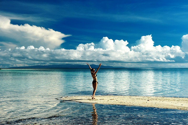 Philippines vacations. Girl on a tropical beach. Philippines travel - vacation travel photos