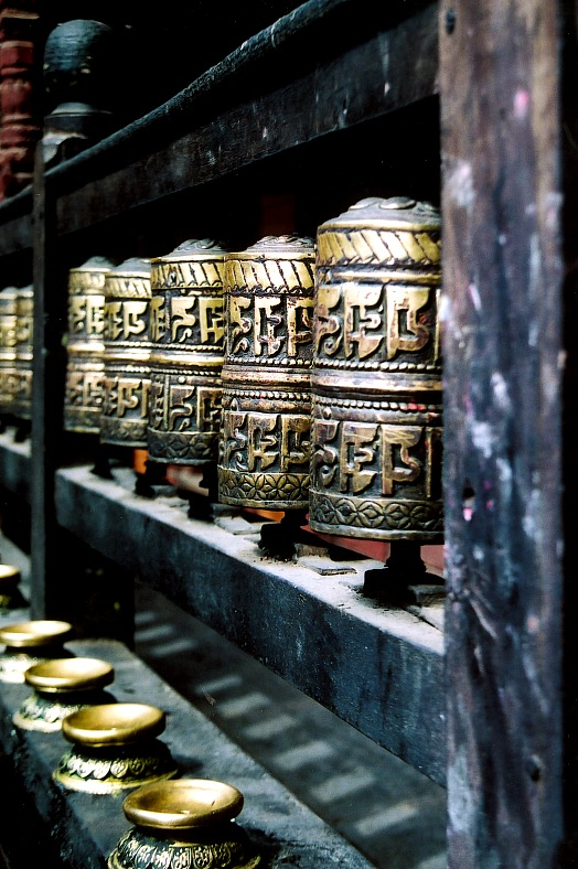 Nepal travel. A series of buddhist prayer wheels in a buddhist temple. Spiritual Nepal vacation.