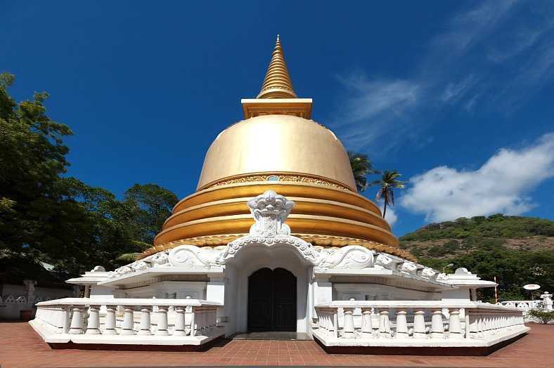 Sri Lanka tourism. Buddhist dagoba (stupa) in Golden Temple, Dambulla. Sri Lanka tours.