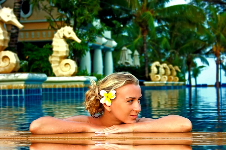 Thailand spa hotels. Young lady enjoying spa procedures in the open air pool. Thailand tours