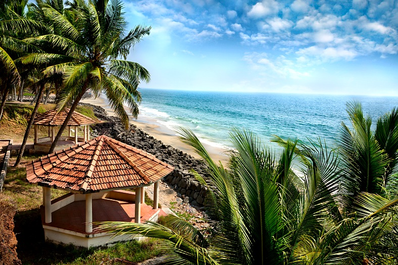 India tours. View of Indian ocean, beach, summer houses and palm trees in Varkala, Kerala. India travel.