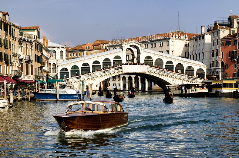 Italy vacations. Rialto bridge with water taxi. Venice tours. Italy travel.