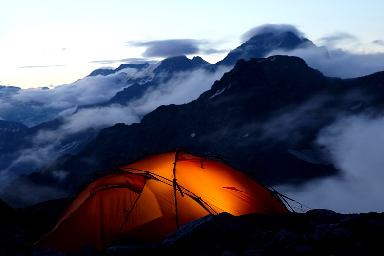Adventure travel - evening in mountains. Adventure holidays.