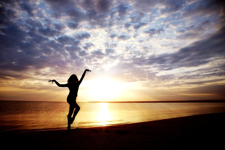 Luxury honeymoon resorts. Woman doing healthy exercise during sunset. All inclusive honeymoons - vacation travel photos
